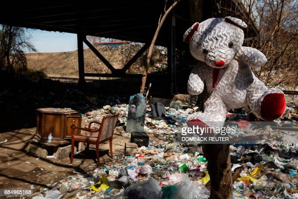 A stuffed toy hangs from a tree near a table and mirror at a heroin encampment in the Kensington neighborhood of Philadelphia Pennsylvania on April...