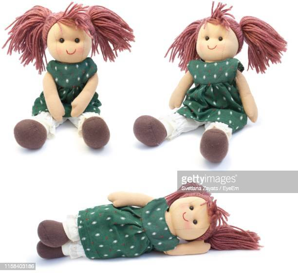 stuffed toys against white background - doll stock pictures, royalty-free photos & images