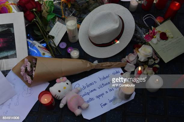 Stuffed toys candles messages flowers and other objects are displayed for the victims of the Barcelona attack on the Rambla boulevard on August 18 a...