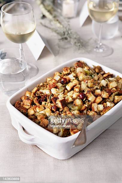 stuffing and wine glasses on table - stuffing stock photos and pictures