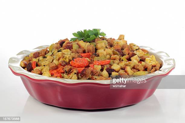 stuffing being served in a red casserole dish - stuffing stock photos and pictures