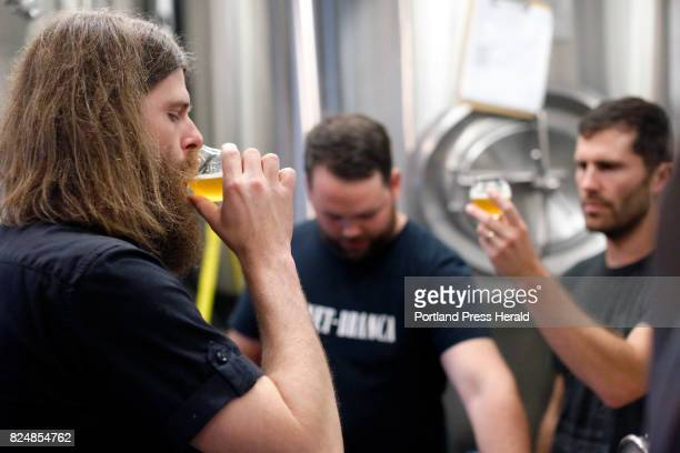Stulli Bjornsson left Terry Peterson and Greg Abbot sample Icelandic beer Thursday at Liquid Riot on Commercial Street Bjornsson a brew master at...