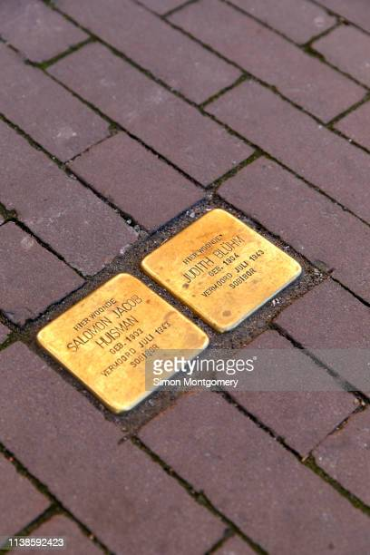 stumbling stones or stolpersteine are holocaust memorial are brass plaques placed in front of the victims last home by the german artist gunter demnig, kloveniersburgwal in amsterdam - {{asset.href}} stock pictures, royalty-free photos & images