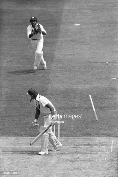 A stump flies as Mohinder Amarnath is bowled for 26 from a Michael Holding delivery