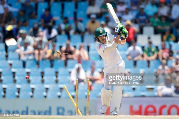 Stumps fly as South African batsman and Captain Faf du Plessis is clean bowled by Indian bowler Ishant Sharma during the second day of the second...