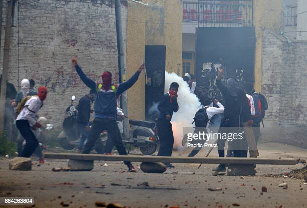 Stun grenade fired by Indian police explodes during clashes. The agitating student were protesting against the Indian police raid in last month in...
