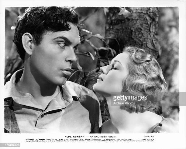 Stunned Jeff York looking at puckering Martha O'Driscoll in a scene from the film 'Li'l Abner' 1940