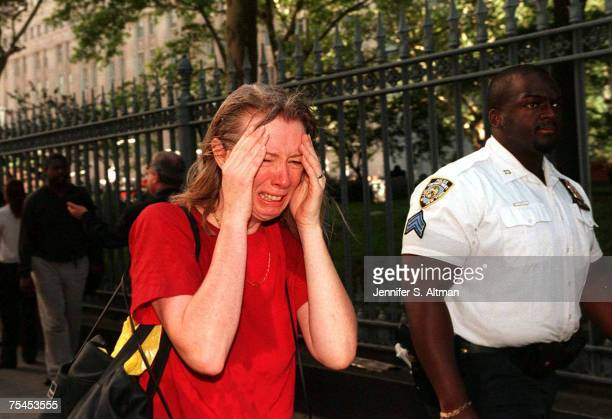Stunned woman fleeing the scene of the terrorist attack on the World Trade Center.