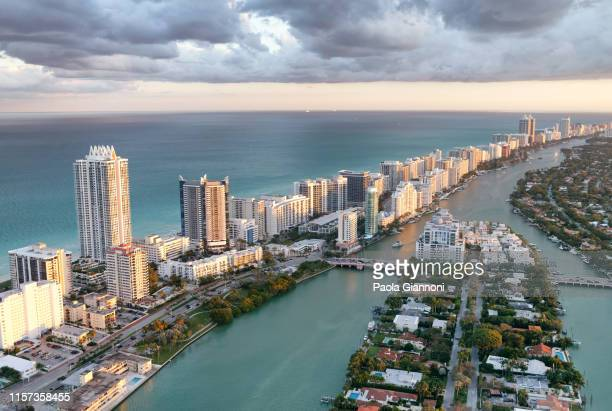 stunning aerial view of south beach. ocean, park and skyscrapers. amazing skyline. miami beach. florida - miami foto e immagini stock