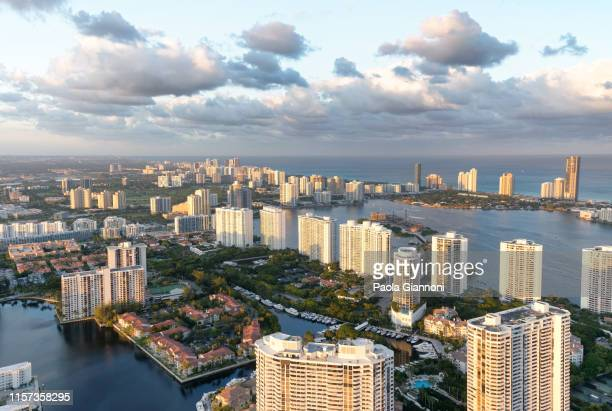 stunning aerial view of south miami beach during a cloudy day - south stock pictures, royalty-free photos & images