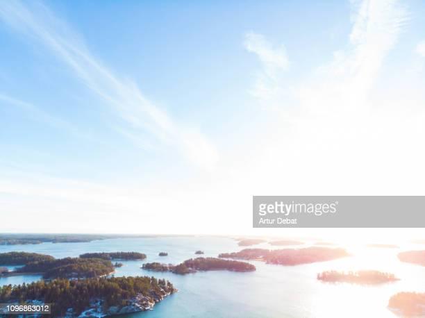 stunning aerial view of the stockholm archipelago islands with sunset light. - arquipélago - fotografias e filmes do acervo