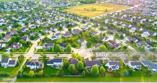 stunning aerial view of vast suburban neighborhoods with field - cul de sac stock pictures, royalty-free photos & images