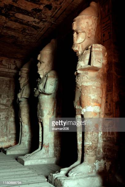stunning architecture and big statue of pharaoh ramesses ii at abu simbel temple near aswan egypt - tomb stock pictures, royalty-free photos & images