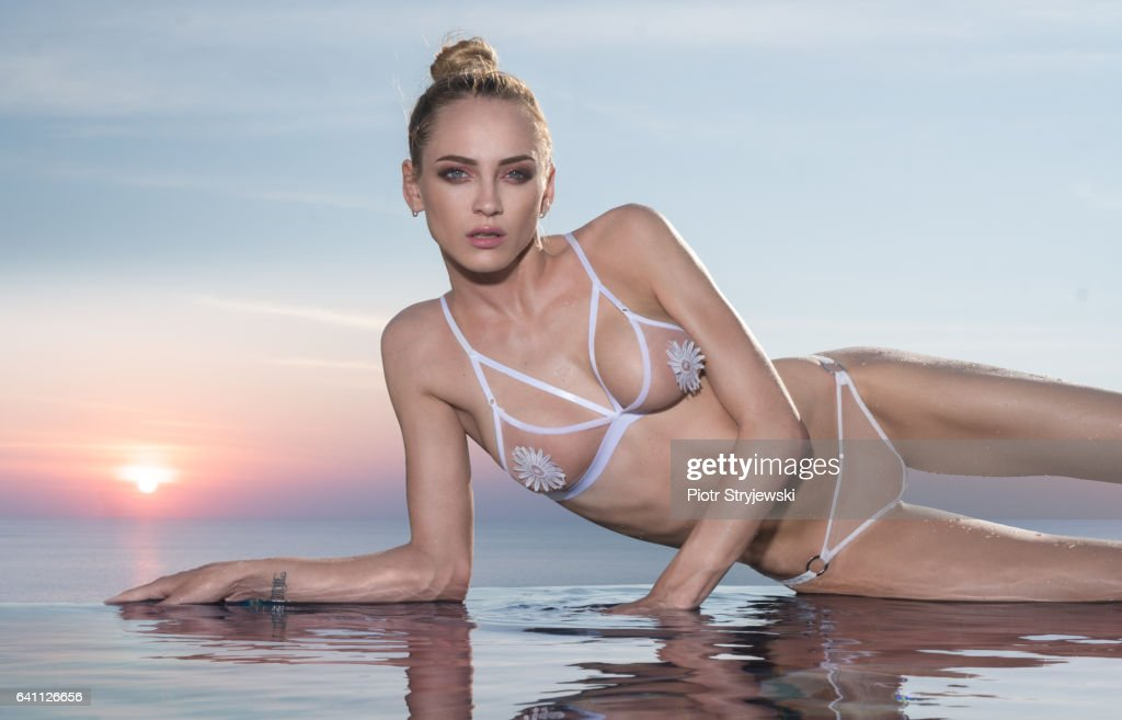 Stunning beauty by the pool : Stock Photo