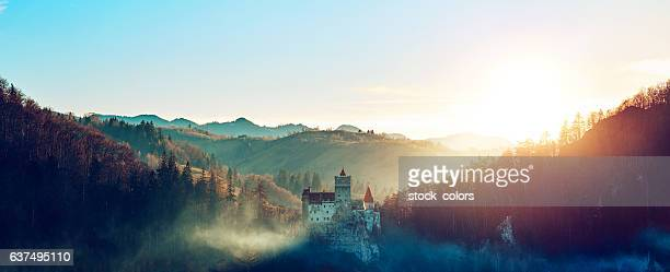 stunning bran castle at sunset - castle stock photos and pictures