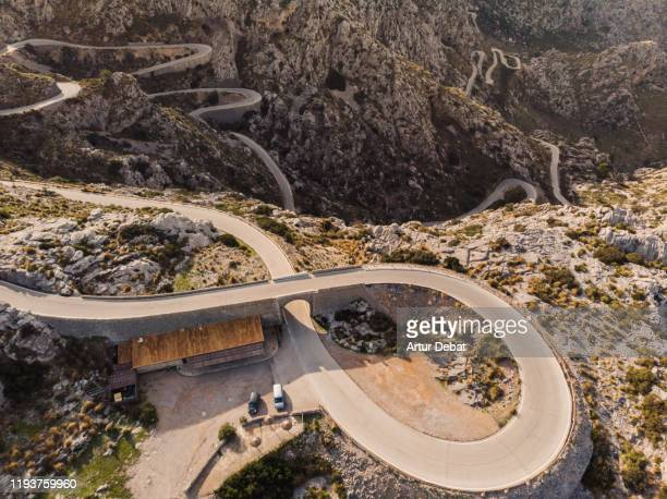 stunning drone view of winding road with helicoid curve in the mountains of mallorca island. - unesco welterbestätte stock-fotos und bilder
