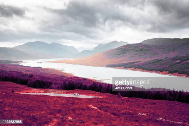 stunning infrared photography landscape of the highlands mountains in scotland. - tranquil scene stock pictures, royalty-free photos & images
