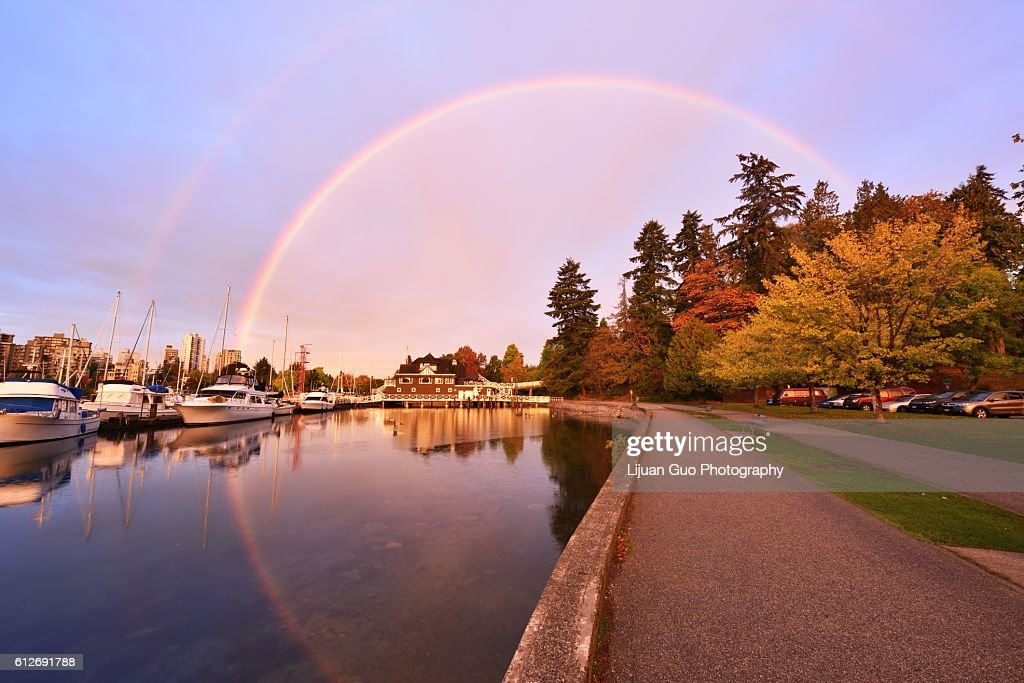 Stunning morning rainbow over yacht club in Stanley Park, Vancouver : Stock Photo