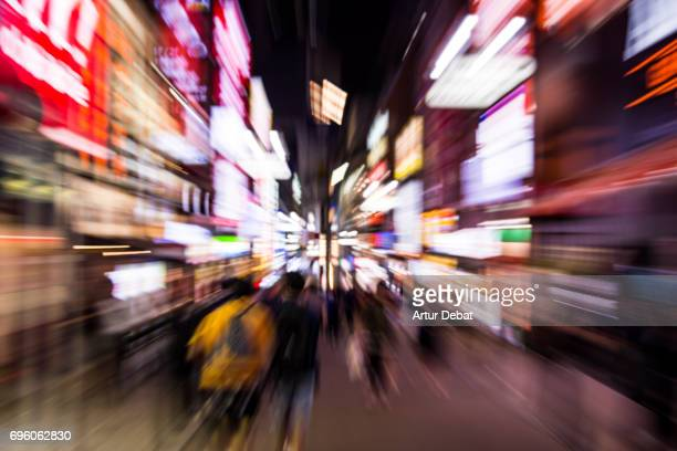 Stunning motion view of the streets the Shibuya at night with forward motion, nice vanishing point and bright lights.