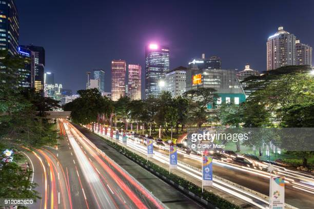 stunning night view of jakarta streets at night, indonesia - emerging markets stock photos and pictures