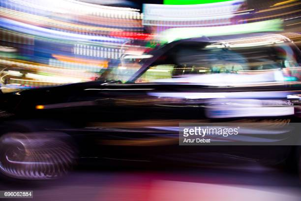 Stunning picture of taxi in motion in the streets of Shibuya with colorful background during travel vacations in Tokyo.