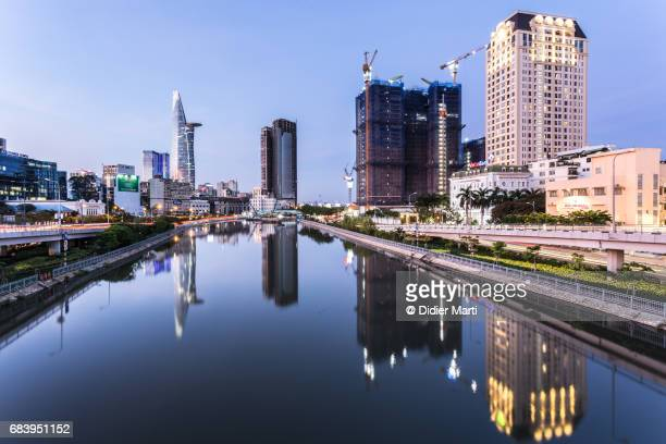 stunning reflection of skyscrapers in ho chi minh city in vietnam - emerging markets stock photos and pictures