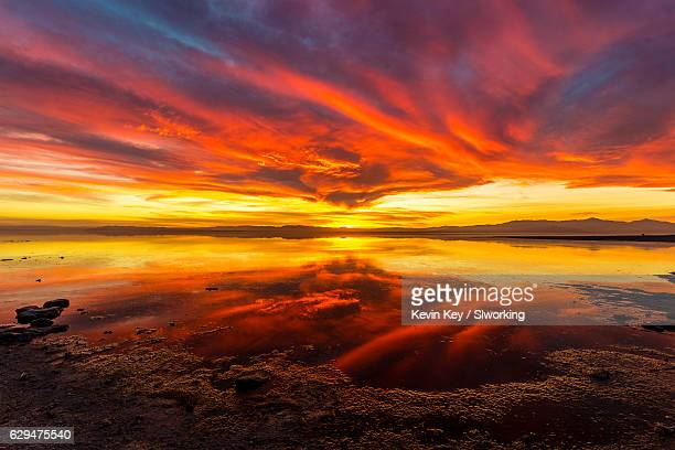 stunning sunset at bombay beach at the salton sea - sunset beach stock photos and pictures