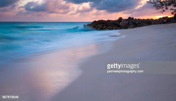 stunning sunset on dover beach in barbados - bridgetown barbados stock pictures, royalty-free photos & images