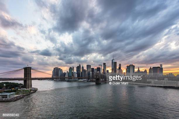 stunning sunset over new york city manhattan district and the east river - didier marti stock photos and pictures