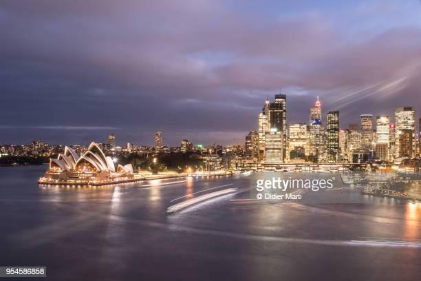 stunning sunset over sydney business district skyline in australia. - sydney stock-fotos und bilder