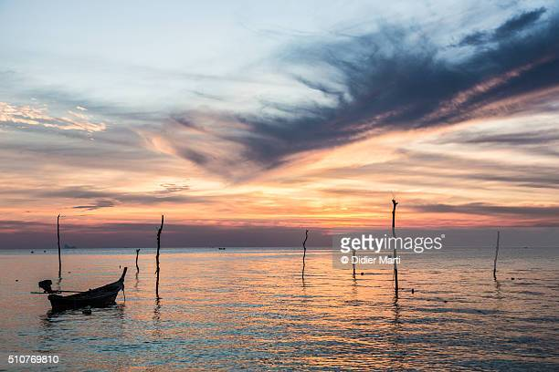 stunning sunset over the andaman sea in thailand - didier marti stock photos and pictures