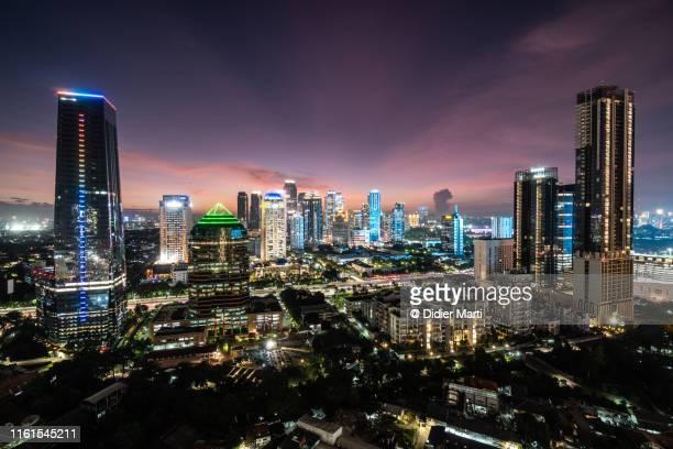 stunning twilight over jakarta south business district, - ジャカルタ ストックフォトと画像