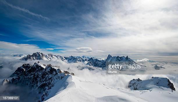 stunning view of snowy mountain above clouds - pyreneeën stockfoto's en -beelden