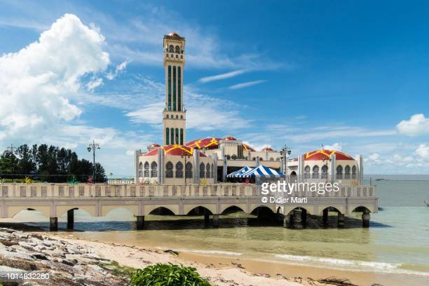 stunning view of the famous floating mosque near georgetown in penang in malaysia - george town penang stock photos and pictures