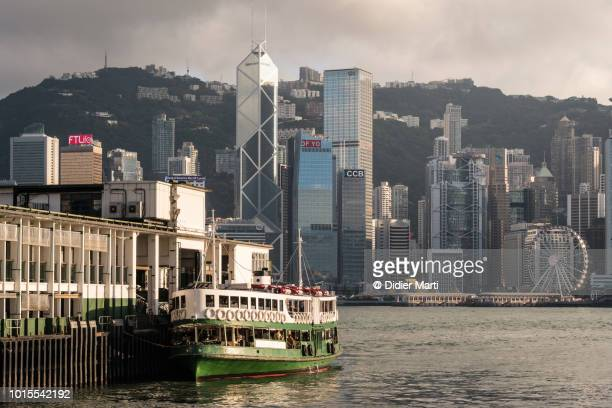 stunning view of the hong kong island famous business district skyline from across the victoria harbor in kowloon in hong kong, - star ferry stock pictures, royalty-free photos & images