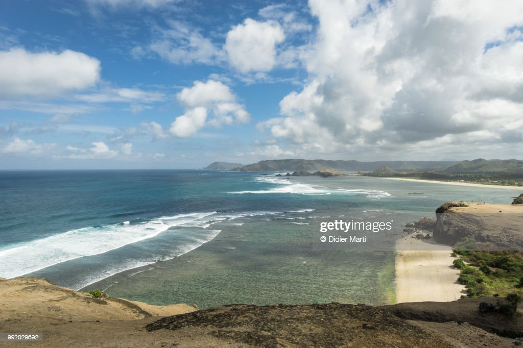 Stunning view of the south Lombok coast toward Kuta from the Marese hill by the Tanjung Aan bay in Lombok in Indonesia : Stock Photo