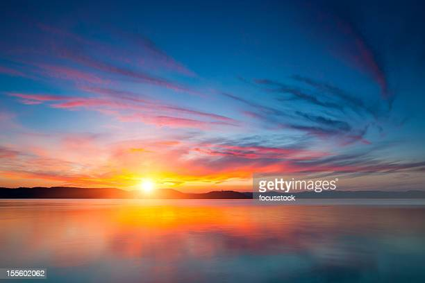 A stunning view of the sunset over water