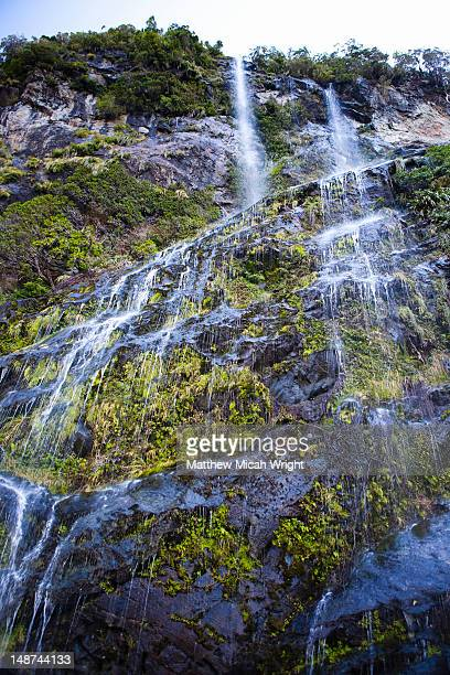 Stunning waterfalls cascading down the steep cliffs of Doubtful Sound
