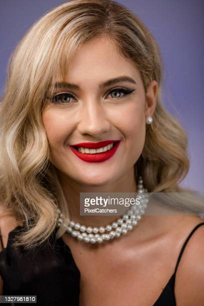 stunning young woman in elegant evening gown smiling to camera - formal glove stock pictures, royalty-free photos & images