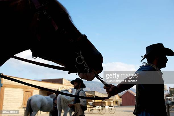 Stunt actors keep horses after a show for tourists at Fort Bravo/Texas Hollywood on August 20 2015 in Almeria Spain Fort Bravo Texas Hollywood built...