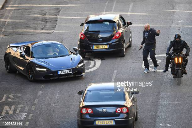 A stunt double on a Triumph motorcycle and a McLaren sports car are driven down Cochrane Street as filming of Fast and the Furious spinoff continues...