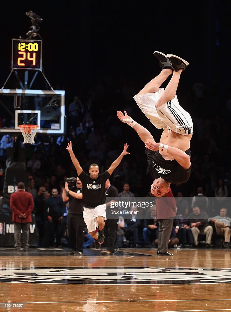Stunt men entertain the crowd during a timeout in the game between the Brooklyn Nets and the Boston Celtics at the Barclays Center on November 15, 2012 in the Brooklyn borough of New York City.