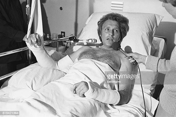 Stunt performer Evel Knievel gives interviews from his hospital bed after suffering a fractured right arm and left collarbone when he lost control of...