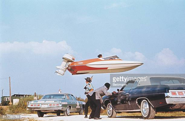 Stunt performer Jerry Comeaux jumps a Glaston GT50 speedboat over police officers and their squads as part of an escape scene from the James Bond...