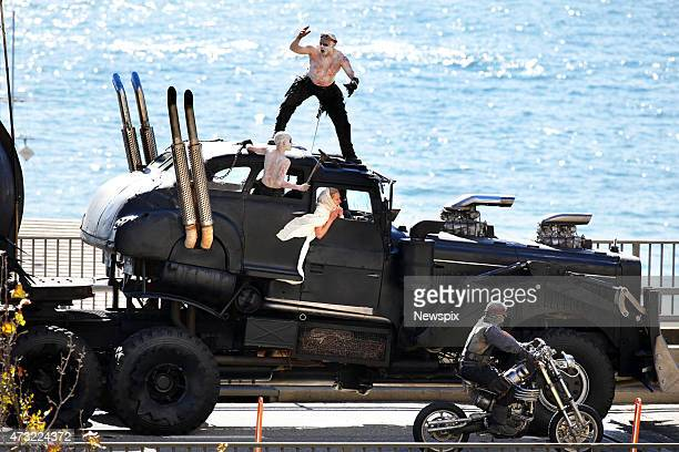 Stunt performers and vehicles are seen along the Cahill Expressway for a special promotion ahead of the premiere of the film 'Mad Max Fury Road' on...