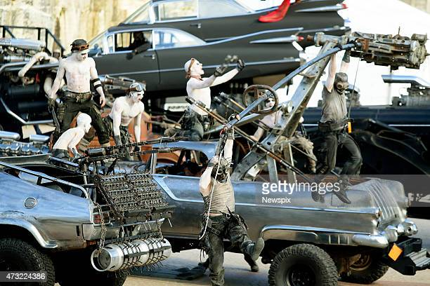 Stunt performers and vehicles showcased at the Sydney Opera House during a special promotion ahead of the premiere of the film 'Mad Max Fury Road' on...
