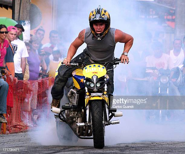 "Stunt pilot of ""Starboys"" motorcycle team performs a burnout during a a motorcycle rally in the streets of the small seaside city of Porto Belo,..."