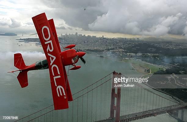 Stunt pilot Sean Tucker flies his Team Oracle biplane near the Golden Gate Bridge as he practices for the 2006 San Francisco fleet week October 5...