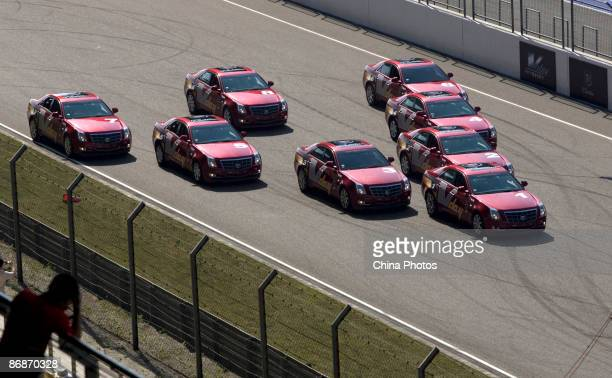 Stunt players showcase Cadillac cars on the Shanghai International Circuit during the Cadillac VDay Track Day on May 9 2009 in Shanghai China