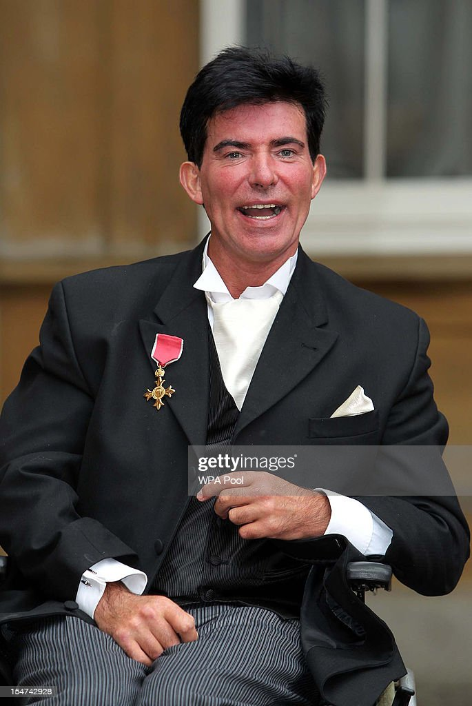 Stunt rider Eddie Kidd poses after he was made an OBE at a Royal Investiture ceremony at Buckingham Palace on October 25, 2012 in London, England.